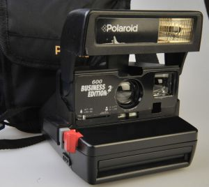 business 600 black polaroid with bag #131 $160
